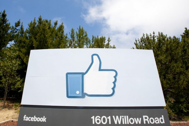 A large thumbs up sign marks the entrance to the Facebook campus in Menlo Park, Calif. Facebook said Monday it will remove deep fake videos, but some say its new policy is not enough. Photo by Terry Schmitt/UPI