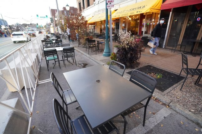 Empty sidewalk tables are seen outside a diner in University City, Mo., on Tuesday. Due to rising COVID-19 cases, St. Louis County has ordered all restaurants closed for indoor seating, but limited outdoor seating is permitted. Photo by Bill Greenblatt/UPI
