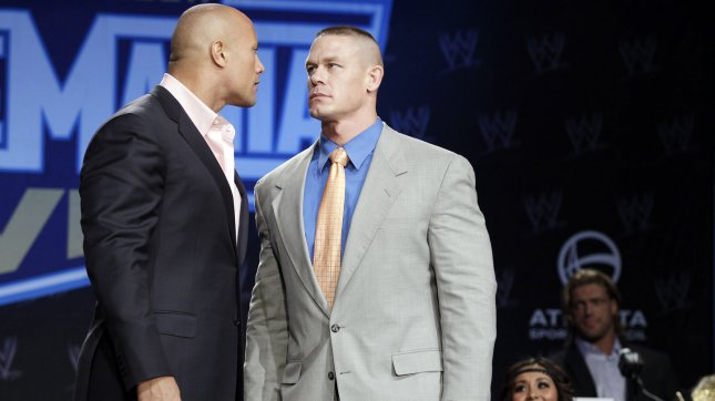 Nicole 'Snooki' Polizzi, watches Wrestler Dwayne 'The Rock' Johnson Wrestler John Cena (R) stand on the stage at the WrestleMania XXVII Press Conference at The Hard Rock Cafe in New York City on March 30, 2011. UPI/John Angelillo