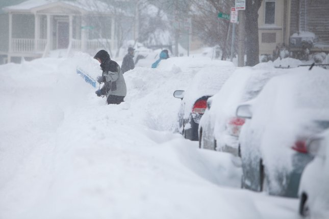 Bostonians start to dig out in Boston, Massachusetts on February 9, 2013, after a blizzard dumped more than two feet of snow in the area. (File/UPI/Jacob Belcher)