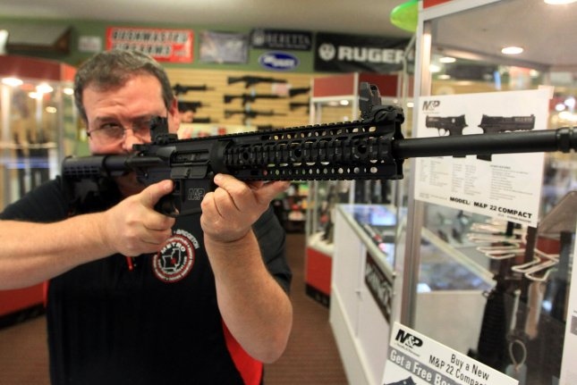 Steven King, owner of a gun supply store, shows an AR-15, 556-caliber rifle. Armor-piercing 5.56mm ammo might be outlawed by the ATF due to its capability of being fired from a handgun. File Photo by Bill Greenblatt/UPI