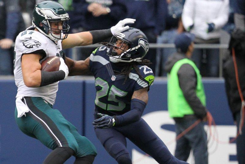 Seattle Seahawks cornerback Richard Sherman (25) wraps up Philadelphia Eagles Tight end Brent Celek (87) at CenturyLink Field in Seattle, Washington on November 20, 2016. Seahawks beat the Eagles 26-15. Photo by Jim Bryant/UPI
