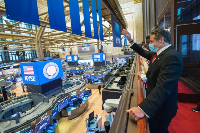 Governor Andrew Cuomo rings the opening bell at the New York Stock Exchange as the NYSE reopens after being closed for two months on Wall Street in New York City on May 26, 2020. Photo by Darren McGee/Office of Governor Andrew M. Cuomo/UPI
