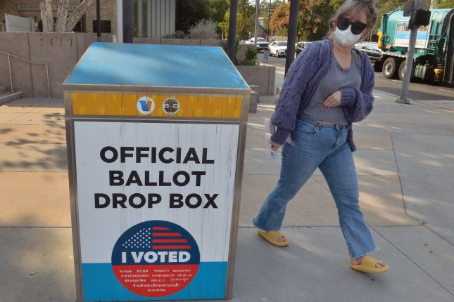 A woman prepares to deposit her ballot in a drop box in the Silver Lake section of Los Angeles, Calif., on October 10. After a troublesome primary election in the spring that was marked by breakdowns and delays at the polls, Los Angeles County officials are approaching the Nov. 3 vote with a new set of challenges brought on by the pandemic. Photo by Jim Ruymen/UPI