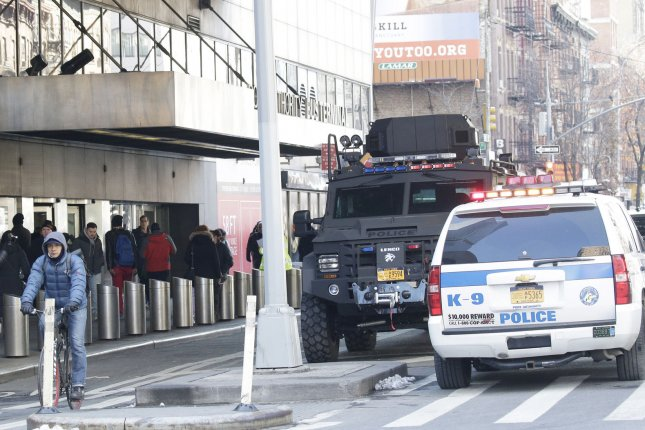 NYPD vehicles remain outside of the entrance to the Port Authority Bus Terminal after a pipe bomb exploded in New York City on December 11, 2017. File Photo by John Angelillo/UPI