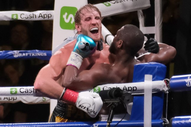 Logan Paul (L) reacts from a hit from Floyd Mayweather Jr. (R) during an exhibition boxing bout Sunday at Hard Rock Stadium in Miami Gardens, Fla. Photo by Gary I Rothstein/UPI