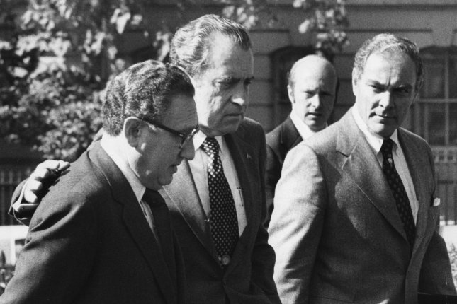 President Nixon is pictured with Chief-of-Staff Alexander Haig (R) and Secretary of state Henry Kissinger (L) at the White House on October 25, 1973. Nixon conferred with Haig before he made his decision to fire special prosecutor Archibald Cox. Photo by Frank Cancellare/UPI