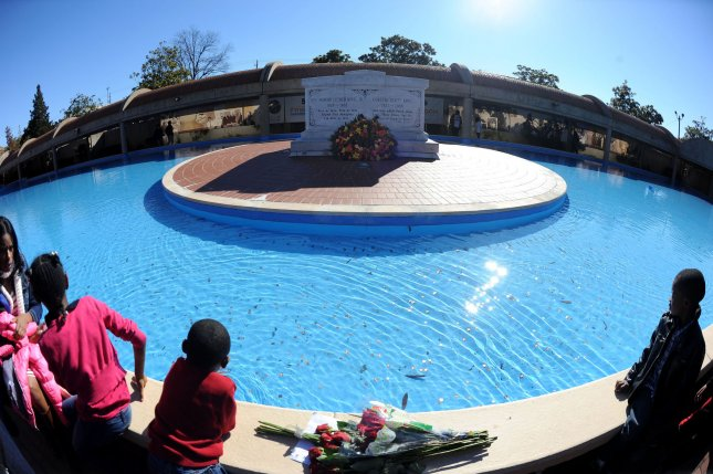 Children view Martin Luther King Jr.'s crypt and reflecting pool during a holiday celebration in the slain civil rights leader's hometown of Atlanta on January 20, 2014. UPI/David Tulis