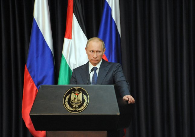 (L) Russian President Vladimir Putin and (R) Palestinian President Mahmoud Abbas, not seen, give statements to the press after a meeting in the Palestinian headquarters in Bethlehem, West Bank, June 26, 2012. UPI/Debbie Hill