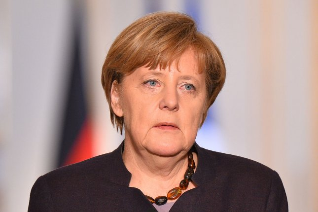 German Chancellor Angela Merkel speaks to the press after meeting with French President Francois Hollande at the Elysee Palace in Paris on November 25, 2015. Photo by David Silpa/UPI