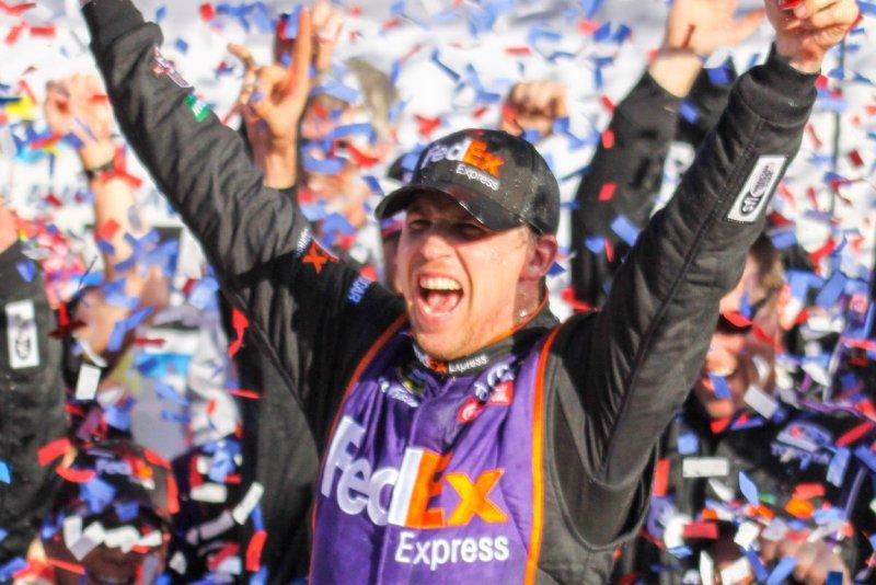 Denny Hamlin celebrates winning the closest Daytona 500 ever at Daytona International Speedway on February 21, 2016 in Daytona, Florida. Photo by Mike Gentry/UPI