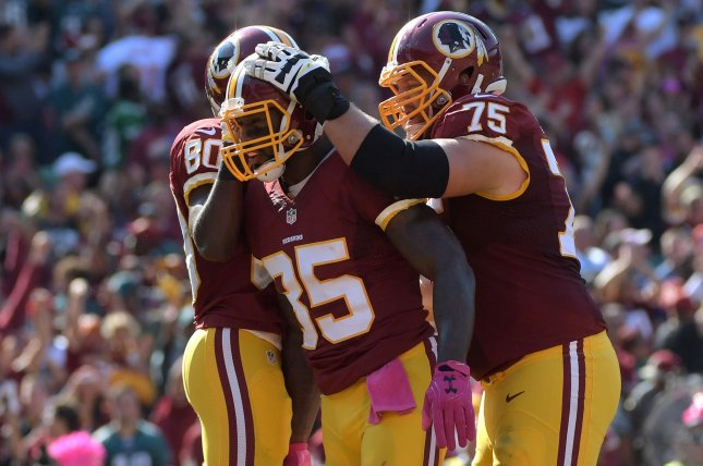 Washington Redskins tight end Vernon Davis (85) celebrates with teammates Jamison Crowder (80) and Brandon Scherff (75) after scoring a touchdown against the Philadelphia Eagles in the second quarter at FedEx Field in Landover, Maryland on October 16, 2016. Photo by Kevin Dietsch/UPI