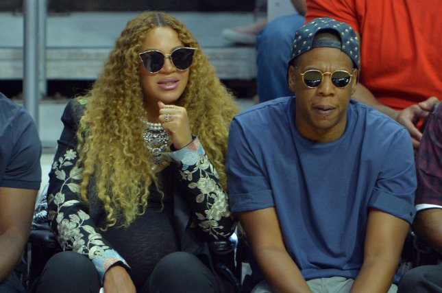 Beyoncé (L) and Jay Z attend a Los Angeles Clippers and Utah Jazz game on April 30. The singer and Blue Ivy, her daughter with Jay Z, served meals at St. Johns Church in Houston. File Photo by Jim Ruymen/UPI