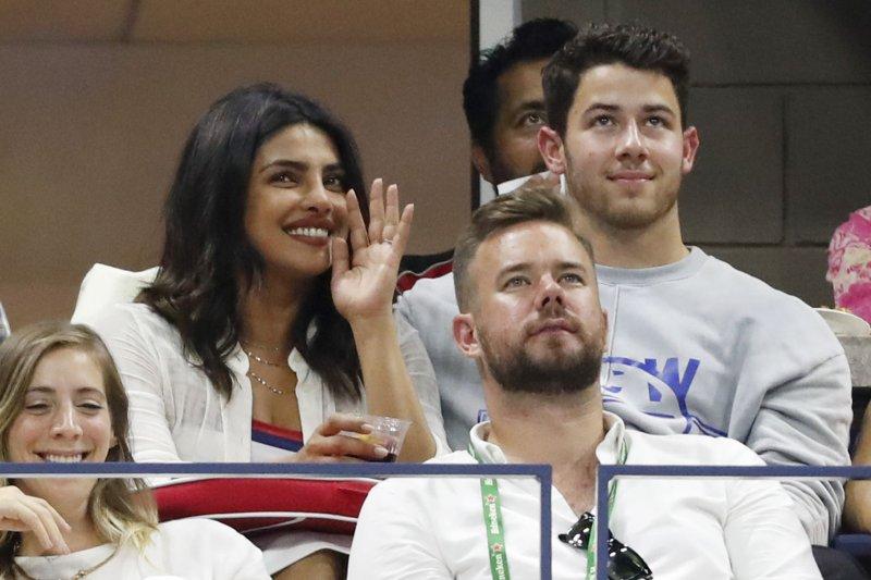 Nick Jonas (R) and Priyanka Chopra attend the U.S. Open tennis championships on Tuesday. Photo by John Angelillo/UPI