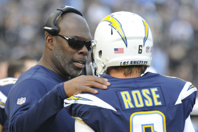 Los Angeles Chargers head coach Anthony Lynn (L) talks to former Chargers kicker Nick Rose in the first half against the Oakland Raiders on December 31, 2017 at the StubHub Center in Carson, California. Photo by Lori Shepler/UPI