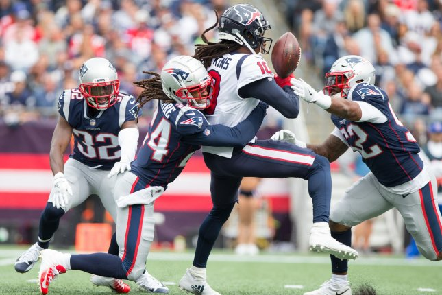 New England Patriots cornerback Stephon Gilmore (24) and linebacker Elandon Roberts (52) break up a pass intended for Houston Texans wide receiver DeAndre Hopkins (10) in the second quarter on September 9 at Gillette Stadium in Foxborough, Mass. Photo by Matthew Healey/UPI