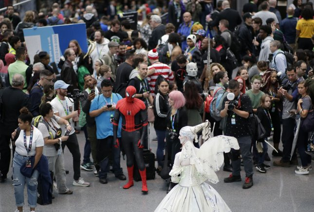 Cosplayers pose for photos at New York Comic Con on October 3, 2019. This year's convention will be online due to the coronavirus pandemic. File Photo by John Angelillo/UPI
