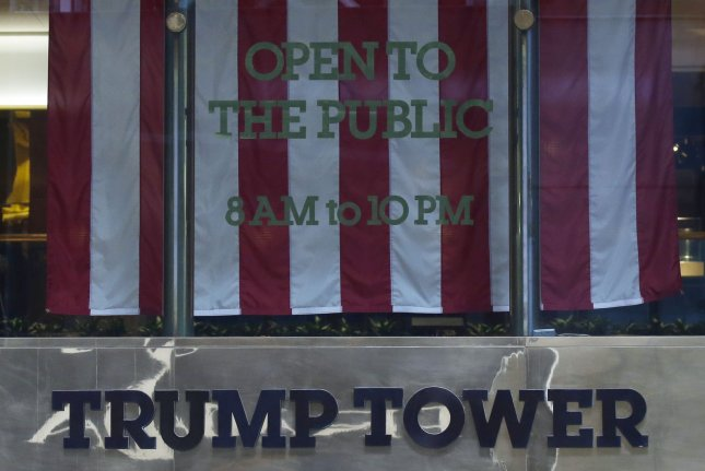 An American Flag hangs in the window of Trump Tower on Fifth Avenue in New York City on August 31. Forbes said Tuesday the value of the tower and most of Trump's holdings fell $600 million since last September. Photo by John Angelillo/UPI