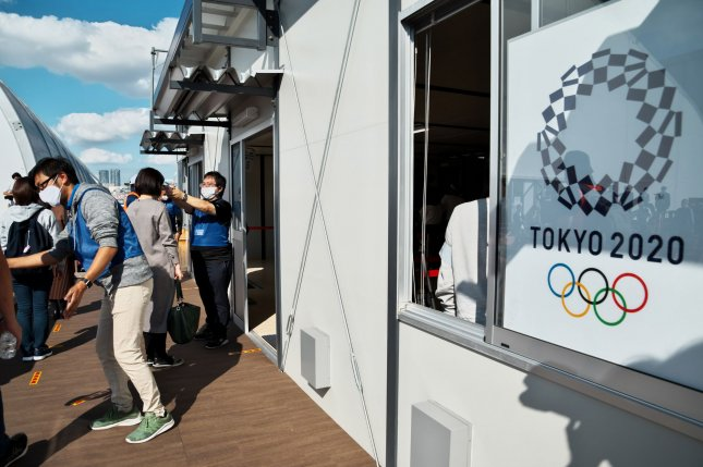 The Tokyo Organizing Committee of the Olympic and Paralympic Games conduct test screening measures for spectators and games officials in Tokyo on October 21. The committee said it will have scaled-back Opening and Closing ceremonies for the Games next summer.Photo by Keizo Mori/UPI