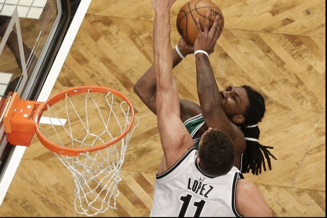 Brooklyn Nets' Brook Lopez leaps to try to block a shot from Boston Celtics' Jae Crowder. Photo by John Angelillo/UPI'