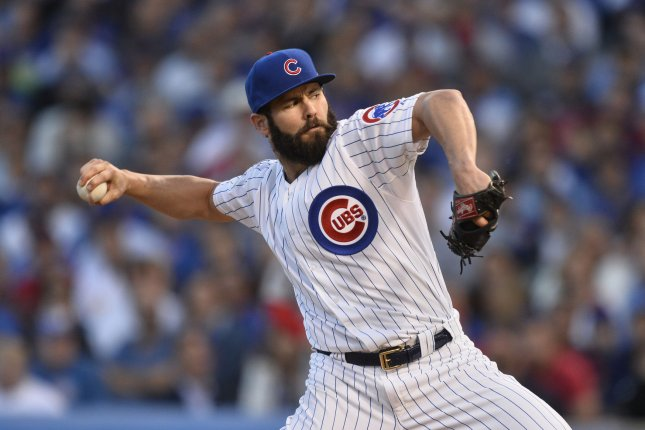 6a84253b3ce Chicago Cubs starting pitcher Jake Arrieta (49) pitches against the St.  Louis Cardinals in the second inning of game 3 of the National League  Division ...