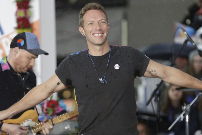 Chris Martin and Coldplay perform on NBC's Today at Rockefeller Center in New York City on March 14, 2016. Martin was spotted strolling a Malibu beach with Heather Graham, sparking dating rumors. File Photo by John Angelillo/UPI