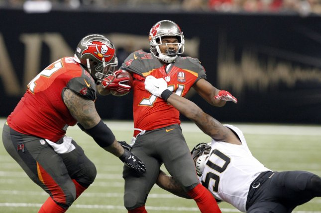 Tampa Bay Buccaneers running back Charles Sims (34) is stopped by New Orleans Saints middle linebacker Stephone Anthony (50) during the second quarter at the Mercedes-Benz Superdome in New Orleans September 20, 2015. Photo by AJ Sisco/UPI