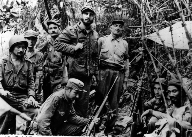 This photo is believed to be the only existing picture of Fidel Castro (center), leader of Cuba's revolutionary forces, and members of his staff and troop commanders made at a secret base near the coast. The group includes five captains, the entire top command of the guerrilla army. UPI File Photo
