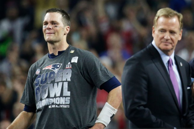 New England Patriots quarterback Tom Brady (L) tears up as NFL Commissioner  Roger Goodell (R) looks on after the Patriots defeated the Atlanta Falcons  in ... f1abfd93a