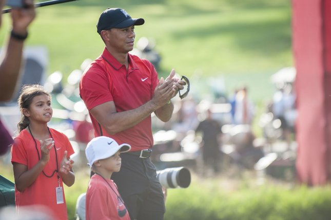 Tournament host, Tiger Woods, looks on with his children, Sam and Charlie (l-r) as the final putts are made during the final round of the Quicken Loans National golf tournament at Congressional CC in Bethesda,Maryland on June 26, 2016. Billy Hurley III, of Annapolis, Maryland, shot a 2-under 69 on Sunday for his first tournament win. Photo by Pete Marovich/UPI