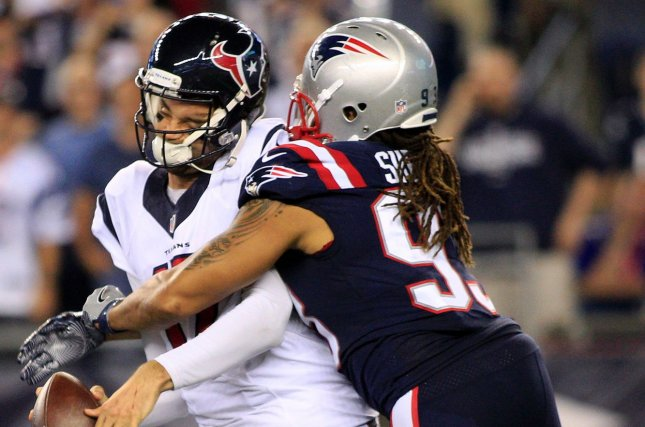 Houston Texans quarterback Brock Osweiler (17) is sacked by New England Patriots defensive lineman Jabaal Sheard (93) in the fourth quarter at Gillette Stadium in Foxborough, Massachusetts on September 22, 2016. The Patriots defeated the Texans 27-0. File photo by Matthew Healey/UPI