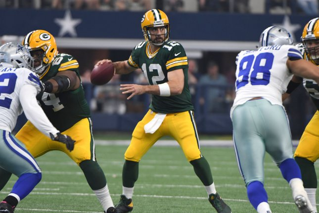 Green Bay Packers Aaron Rodgers looks to throw against the Dallas Cowboys at AT&T Stadium in Arlington, Texas on October 8, 2017. File photo by Ian Halperin/UPI