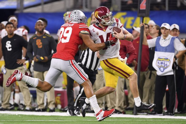 Ohio State Buckeyes linebacker Malik Harrison (39) pushes USC Trojans quarterback Sam Darnold (14) out of bounds in the Goodyear Cotton Bowl Classic on December 29, 2017 at AT&T Stadium in Arlington, Texas. Photo by Shane Roper/UPI