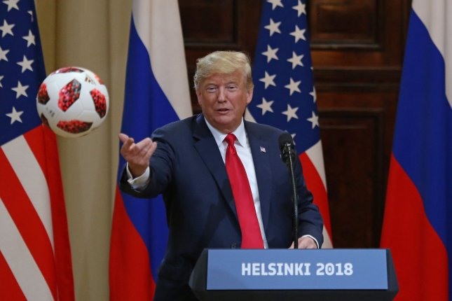 U.S. President Donald Trump throws a soccer ball he received from Russian President Vladimir Putin during a joint press conference at the Presidential Palace in Helsinki, Finland, on Monday. Photo by David Silpa/UPI