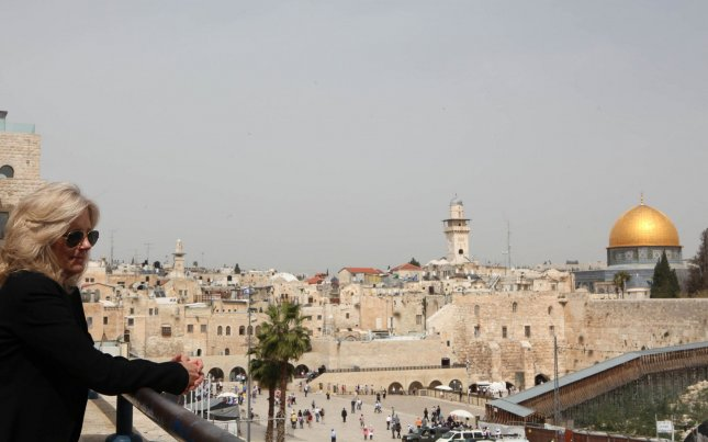 Jill Biden, wife of U.S. Vice President Joe Biden, visits Jerusalem's Old City on March 9, 2010. On the right, the Dome of the Rock Mosque, in the Al-Aqsa Mosque compound, or Temple Mount and the Wailing Wall (R-bottom). UPI/Gali Tibbon/Pool