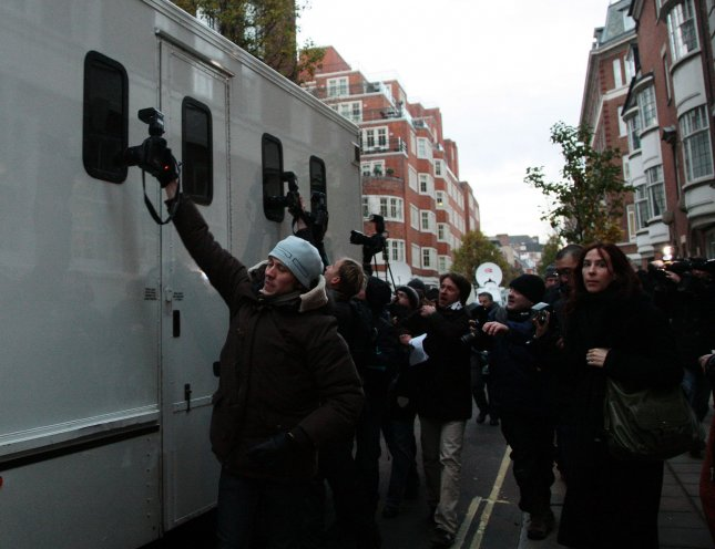 Media surround a police van containing WikiLeaks chief Julian Assange after a bail hearing at Westminster magistrates court in London on December 7, 2010. Assange was denied bail by a British court after he was arrested on accusations of sex crimes in Sweden. Assange is fighting extradition. UPI/Hugo Philpott