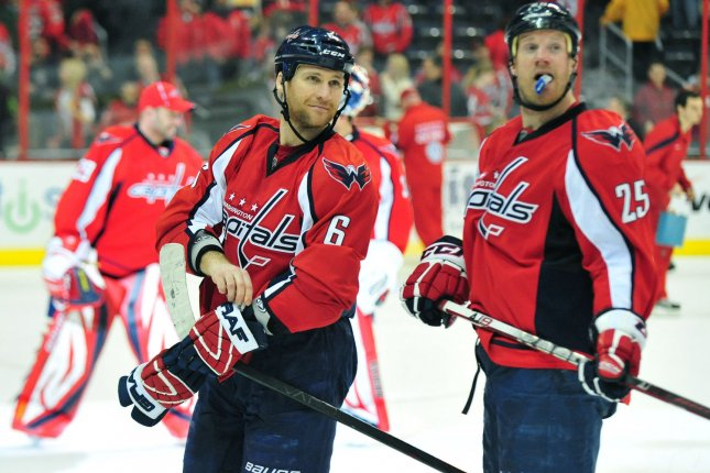 Former Washington Capitals' Dennis Wideman and Jason Chimera are seen on the ice after the Capitals defeated the Toronto Maple Leafs 2-0 at the Verizon Center in Washington on March 11, 2012. UPI/Kevin Dietsch