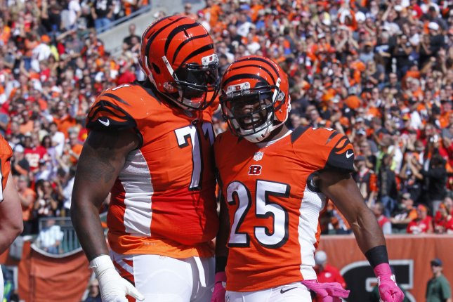 Cincinnati Bengals' Giovani Bernard (25) celebrates his touchdown with Andre Smith (71) during the second half of play agains the Kansas City Chiefs at Paul Brown Stadium in Cincinnati, Ohio, October 4, 2015. Photo by John Sommers II/UPI