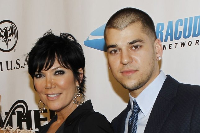 Rob Kardashian (R) and mom Kris Jenner at the Leather and Laces party on February 5, 2010. File Photo by John Angelillo/UPI