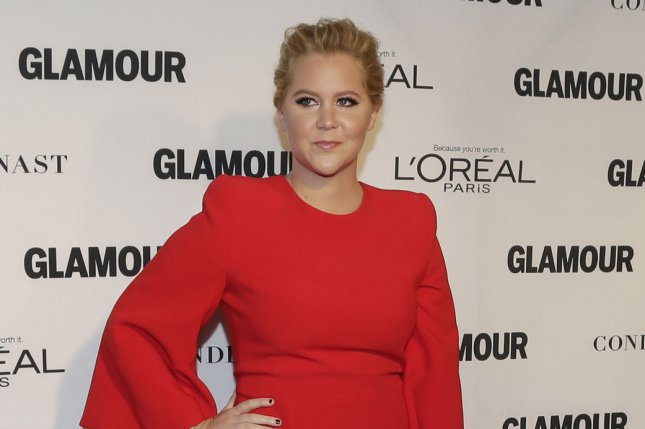 Amy Schumer arrives on the red carpet when Glamour Celebrates the 25th anniversary of the Woman of the Year Awards on November 9, 2015. Schumer has responded to critics of her recent Barbie casting on social media with a body-positive message. File Photo by John Angelillo/UPI