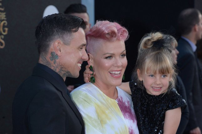 Pink (C) with Carey Hart (L) and daughter Willow at the Los Angeles premiere of Alice Through the Looking Glass on May 23. File Photo by Jim Ruymen/UPI