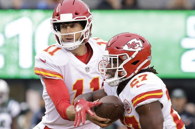 Kansas City Chiefs quarterback Alex Smith hands the football off to Kareem Hunt in the second half against the New York Jets in Week 13 of the NFL season on December 3 at MetLife Stadium in East Rutherford, N.J. Photo by John Angelillo/UPI