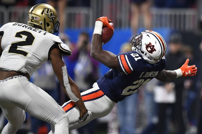 Auburn Tigers running back Kerryon Johnson (21) scores a touchdown against University of Central Florida Knights linebacker Chequan Burkett (2) during the Chick-fil-A Peach Bowl NCAA football game on January 1 at the Mercedes-Benz Stadium in Atlanta, Ga. Photo by David Tulis/UPI