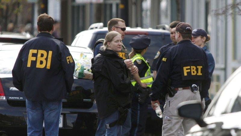 FBI agents congregate on Cambridge Street in Cambridge, Massachusetts on April 19, 2013. UPI/Matthew Healey