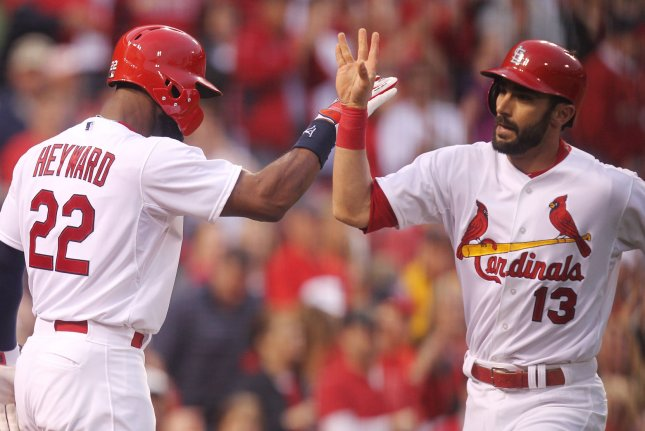 St. Louis Cardinals Matt Carpenter (R) is greeted at home plate by Jason Heyward after hitting a solo home run in the first inning against the Cincinnati Reds at Busch Stadium in St. Louis on April 19, 2015. St. Louis defeated Cincinnati 2-1. Photo by Bill Greenblatt/UPI