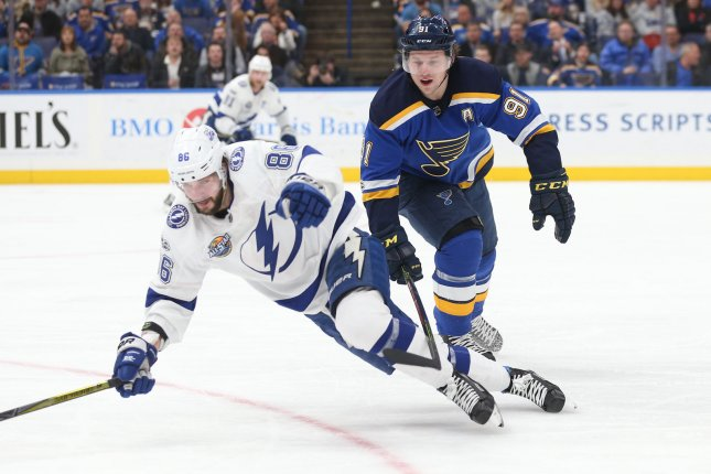 St. Louis Blues' Vladimir Tarasenko of Russia pulls down Tampa Bay Lightning's Nikita Kucherov of Russia with his stick during the first period at the Scottrade Center Tuesday in St. Louis. Photo by Bill Greenblatt/UPI