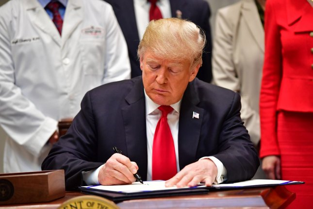 President Donald Trump signs the Know the Lowest Price Act the Patient Right to Know Drug Prices Act during a ceremony at the White House in Washington, D.C., October 10, 2018. Photo by Kevin Dietsch/UPI