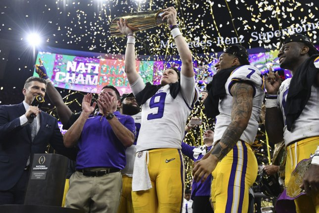 LSU quarterback Joe Burrow raises the championship trophy after his team defeated Clemson to win the College Football Playoff national championship Monday night at the Superdome in New Orleans. Photo by Pat Benic/UPI