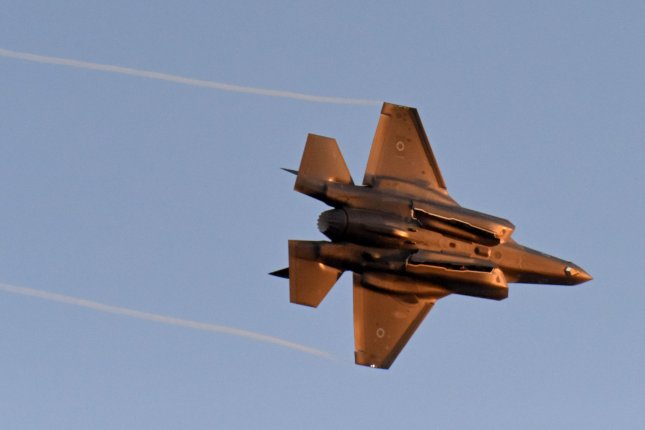An Israeli Air Force Lockheed Martin F-35 combat aircraft flies during the graduation ceremony at the Hatzerim Air Force base in the Negev Desert on June 27, 2019. The Syrian Observatory for Human Rights said Israeli airstrikes killed more than 50 Wednesday morning. Photo by Debbie Hill/UPI