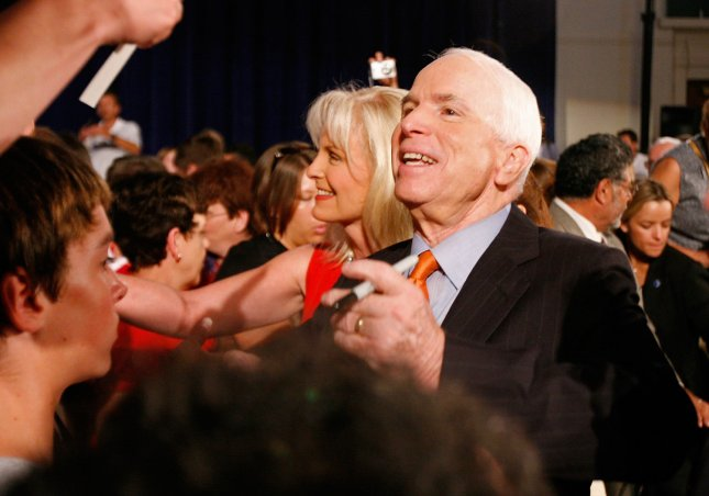 Presumptive Republican presidential nominee Sen. John McCain (R-AZ) and his wife Cindy (L) shake hands with the crowd after a town hall meeting on July 31, 2008 in Racine, Wisconsin. New polls show McCain is closing in on his Democratic rival Sen. Barack Obama (D-IL) in Ohio and Florida. (UPI Photo/Brian Kersey)